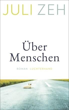 """Vorderansicht des Buches """"Über Menschen"""" mit Hund auf Straße"""